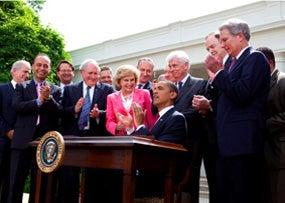 ObamaSignsCARDAct_ChuckKennedy_WikimediaCommons