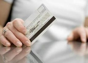 Credit Card Delinquencies Fall as Balances Grow