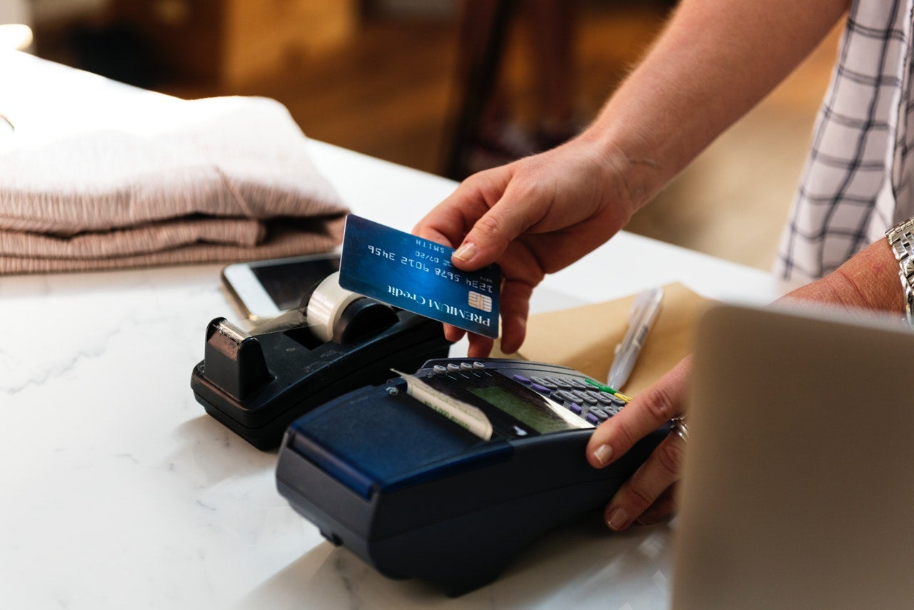 Credit card being run through a card reader.