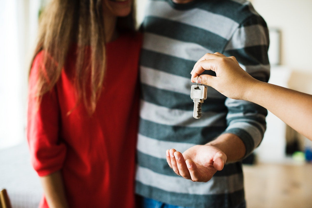 Couple being handed the keys to their new home