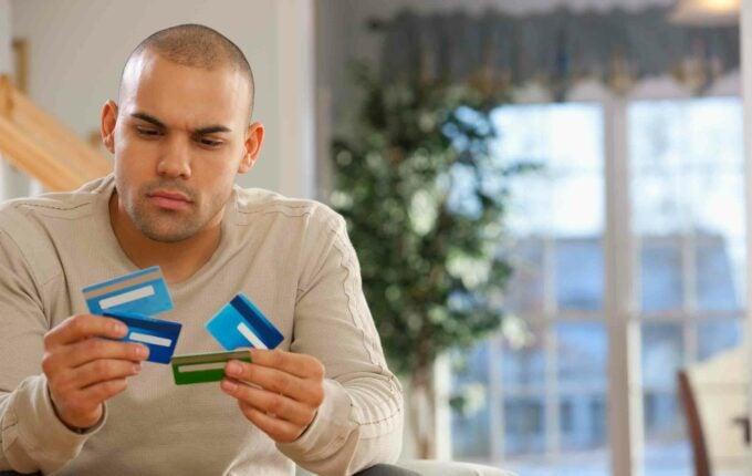 man_chooses_card