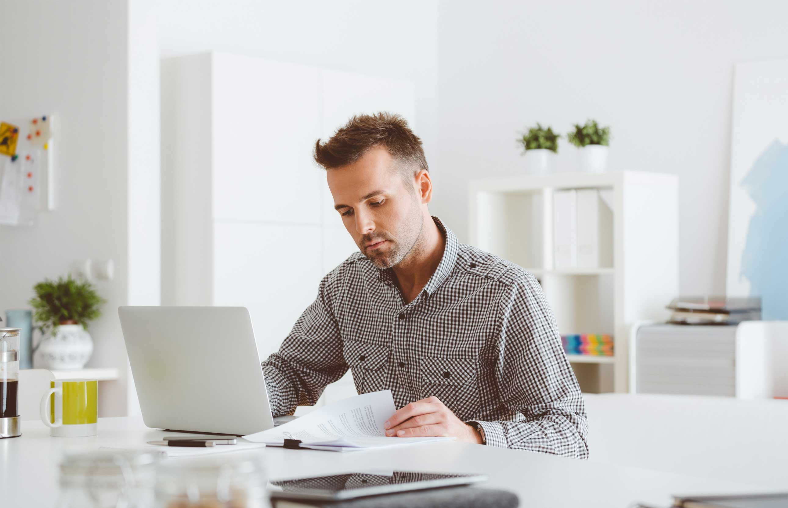 Man at computer reading how to file taxes for free