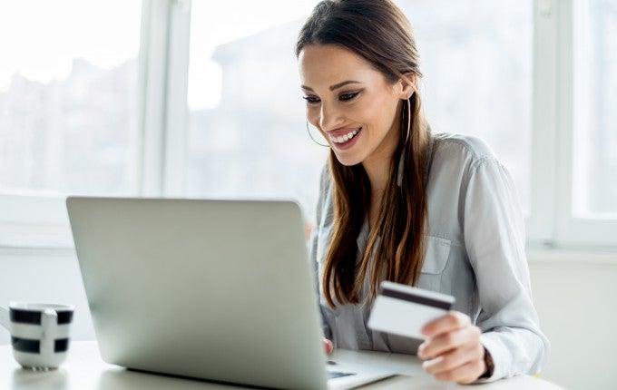 Millennial enjoying American Express Gold Card