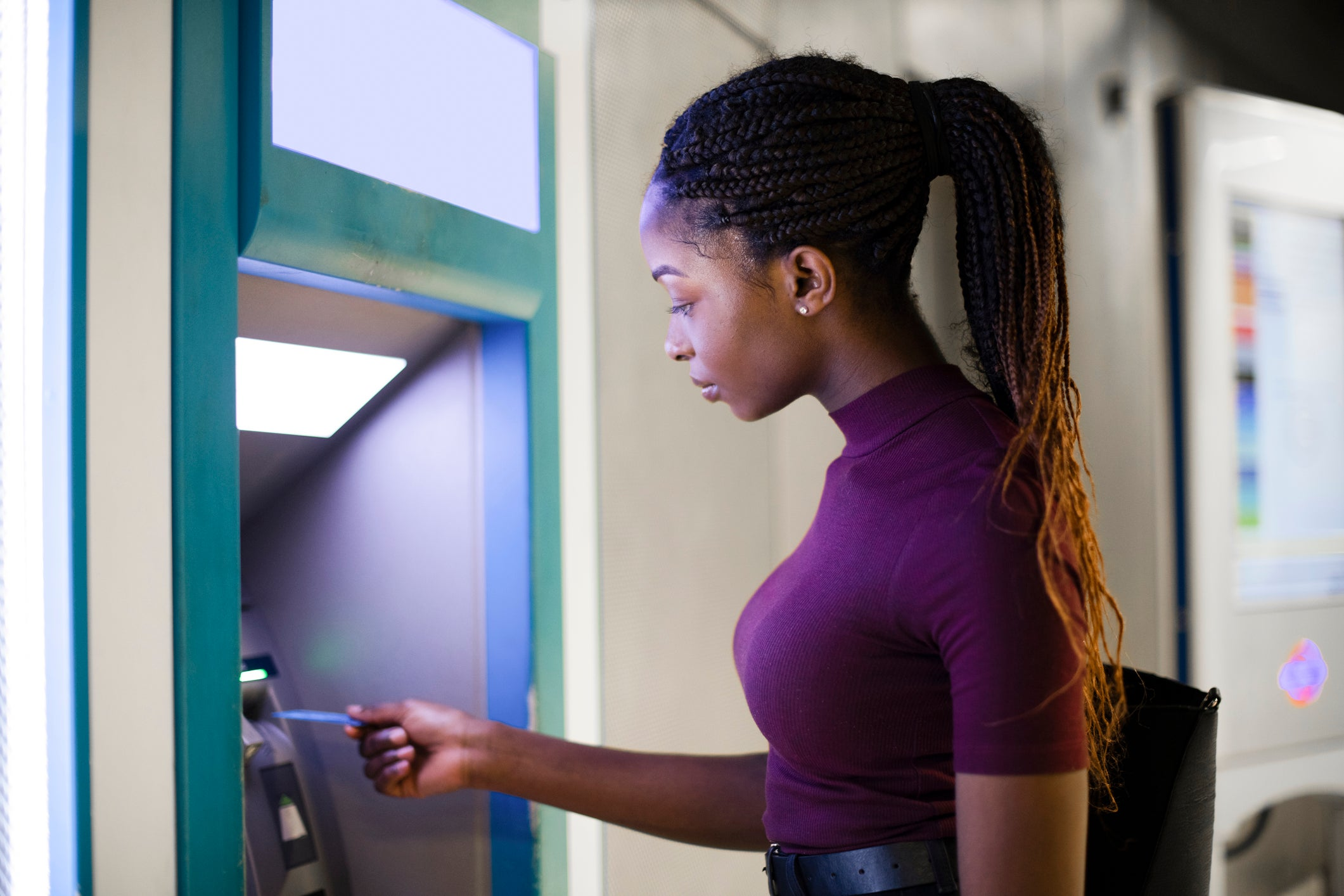 Woman uses ATM
