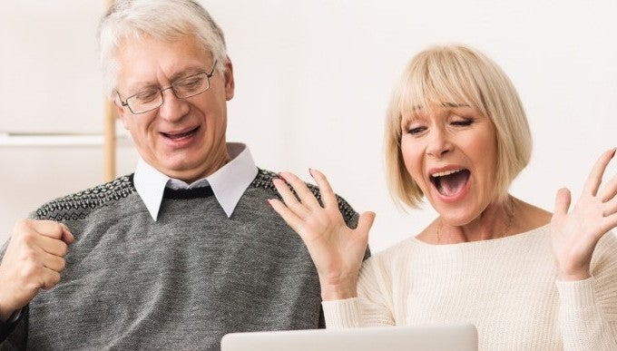 excited-senior-couple-celebrating-victory-winning-online-auction-bid-picture-id1127572892