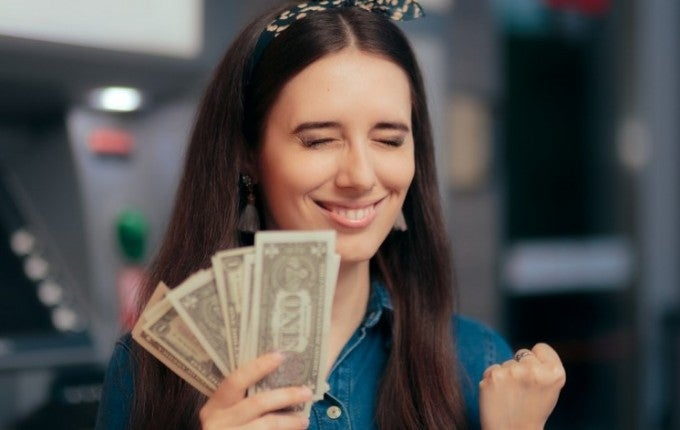 woman with money in hand excited to find unclaimed money
