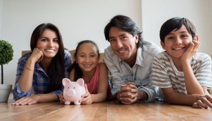 family-savings-money-for-their-new-house-picture-id646688522