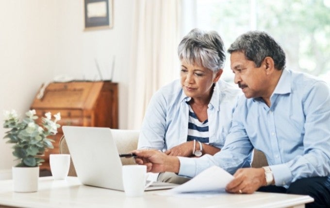 "An elderly couple sits at their couch contemplating the question, ""Does opening a CD affect my credit rating?"""
