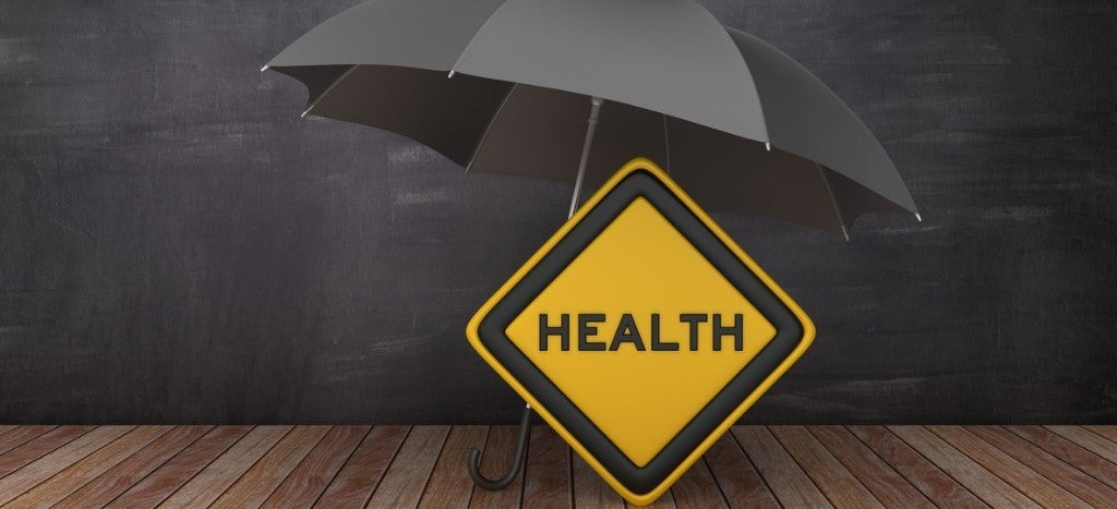 """black umbrella over yellow """"health"""" street sign to convey health insurance protects personal finances"""