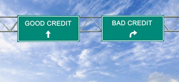 road sign pointing to good credit and bad credit scores