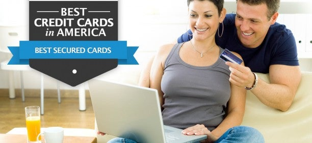 Couple with laptop looking online for the best secured credit card of 2019
