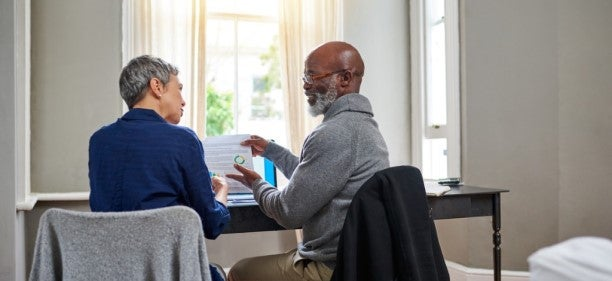 older couple discussing hsbc savings account in their living room